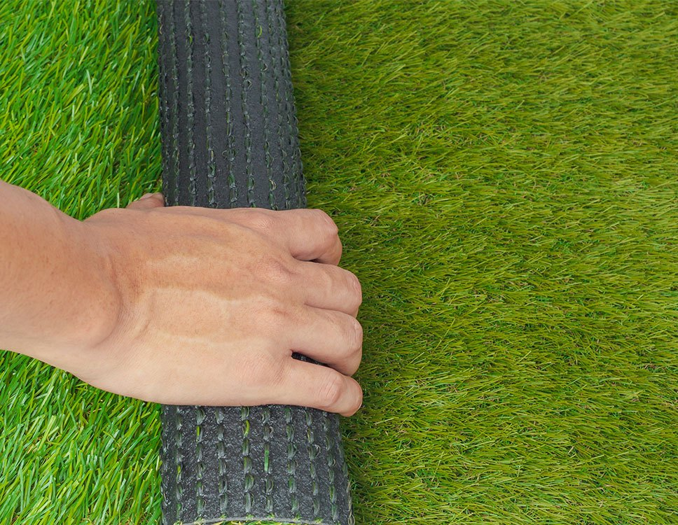 Hand Holding Artificial Lawn